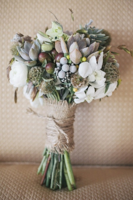 muted bouquet wrapped in burlap